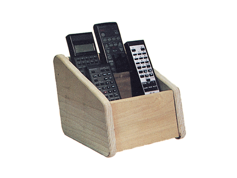 Remote holder is mad eof wood and gathers up all the different remote controls found around the room