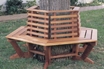 Rustic wood tree seat wraps around trunk