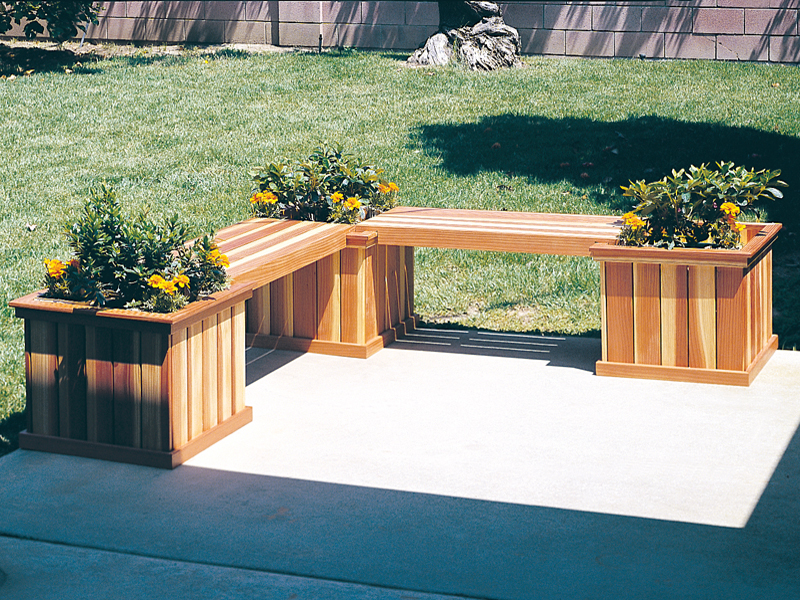 L-shaped planter bench has three square planters and two sections of bench space for the patio